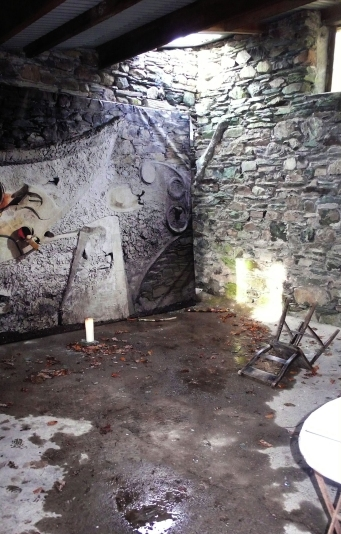Interior of the Merz Barn with broken skylight, after Storm Katie