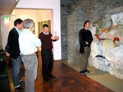 Adam Lowe of Factum Arte, Madrid, examining the original Merz Barn wall in the Hatton Gallery, April 2007.