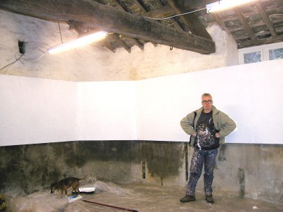 Artist John Baldwin in the Shippon, after helping to paint the display panels. February 2007.