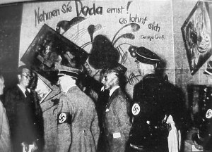 'Take Dada Seriously', newspaper photo of Hitler visiting the 1937 exhibition of so called Degenerate Art in Munich.