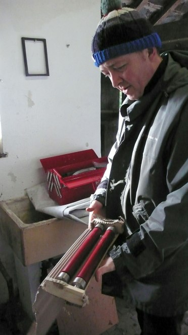 Giles Hovenden with the new rollers for the printing press