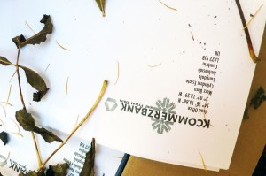 Kcommerz letterhead designed by artist Adam chodzko.