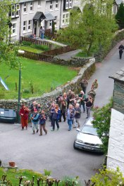 The Cumbrian Fiddlers processing through Chapel Stile before entering the Holy Trinity churchyard to play at William Irwin's graveside, May 6 2012.