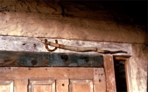 Schwitters' Snakestick in situ above the door to the Merz Barn, c. 1970.
