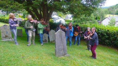 The Lakeland Fiddlers, led by Carolyn Francis, playing at the graveside of William Irwin, Langdale Fiddlet.