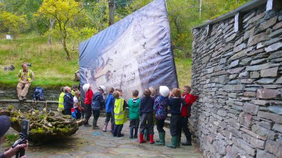 Children from Langdale School moving the image of Schwitters' Merz Barn artwork, in commemoration of the removal of the work in September 1965.