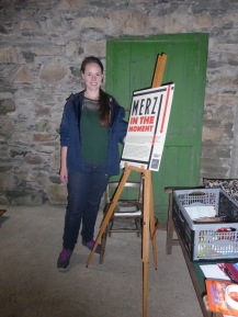 Shannon Quigley, Curator of the Abbott Hall Dementia Group exhibition 'Merz In the Moment' in the Merz Barn.