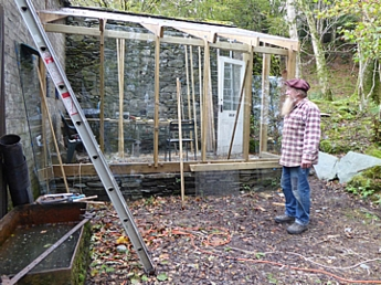 Steve Grundy with his glasshouse